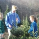 Sam teaching his granddaughters to top trees