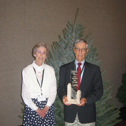 Sam Cartner was recognized for his years of service to the industry when he was presented with the Lifetime Achievement Award at the 2006 National Christmas Tree Association Biennial Convention in Portland, OR.